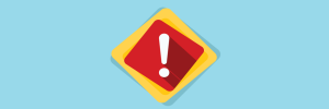 Imagem de uma placa em vermelho indicando alerta. Essa imagem simboliza o artigo sobre laboratórios de metrologia.